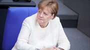 Merkel on refugee crisis deal with Greece; Die Welt links agreement with VAT hike postponement